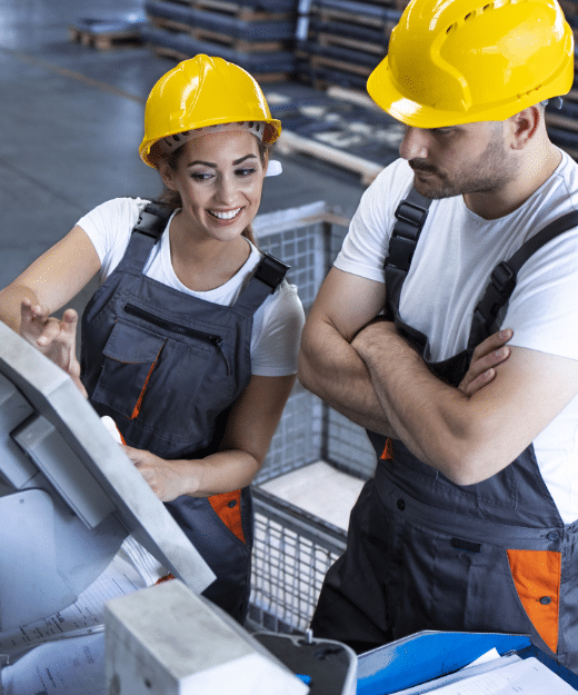 industrial-employees-with-yellow-hardhat-operating-machines-at-production-line-using-new-software-computer